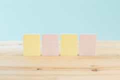 Color blank sticky notes & x28;post it& x29; on wooden desk Stock Images