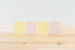 Color blank sticky notes & x28;post it& x29; on wooden desk Stock Image