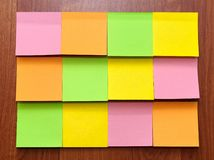 Color blank sticky notes. On wood board Royalty Free Stock Image