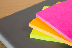 Color block of paper notes. Wooden background Royalty Free Stock Photo