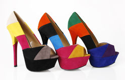 Color block shoes. Multicolored shoes on a white background stock images