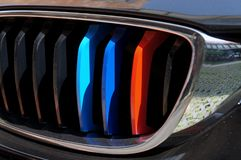 3 color blue , dark blue, red on the front grill car stock images