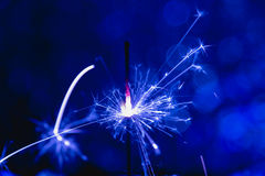 Color blue style. Christmas and New Year party sparkler with abstract circular bokeh background Stock Photography