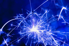 Color blue style. Christmas and New Year party sparkler with abstract circular bokeh background Stock Images