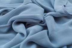 Color blue textil, silk fabric with pleats Stock Photo
