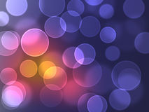 Color Bokeh against a dark background for use at graphic design Royalty Free Stock Image