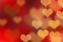 Color Bokeh dark background with hearts for use in graphic desig Royalty Free Stock Photo