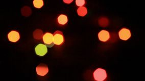Color bokeh with defocused garland.Christmas lights defocused background stock video footage