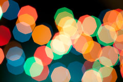 Color Bokeh on a green background. Hexagon. Stock Photos