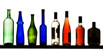 Color bottles on a white background. Color glass bottles with liquid on a white background Stock Photos