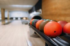 Color bowling balls in feeder, bowl game concept royalty free stock photos
