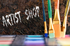 Color box and brushes, words artist shop Stock Photos