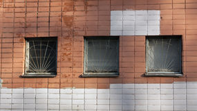 Color brick wall and three windows. Stock Images
