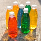Color, bright creative background. Colored bottles Royalty Free Stock Photo