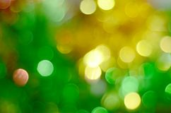 Green and yellow bokeh lights defocused background. Glamour, christmas, decorative, celebration stock photo