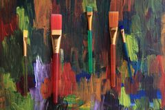 Color brushes on the palette. As nice background royalty free stock photos