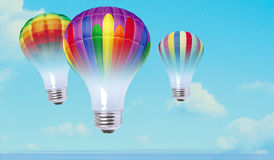 Color bulbs. In the sky as balloons Royalty Free Stock Photo