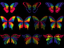 Color butterflies on the black background Stock Photos