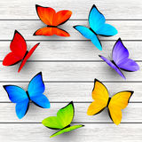 Color butterflies on wooden background 5 Stock Photo