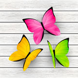 Color butterflies on wooden background Royalty Free Stock Photo