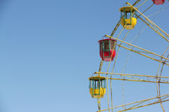 Color cabins of a ferris wheel against the blue sky Royalty Free Stock Images