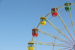 Color cabins of a ferris wheel against the blue sky Stock Photo