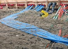 Color cables heap on sand, technology diversity, Stock Photos