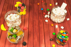 Color candies on wooden background. Copy space Stock Photo