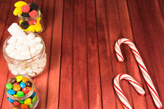 Color candies on wooden background. Copy space Stock Photos
