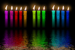 Color candles Happy New Year flooding in water Royalty Free Stock Photos
