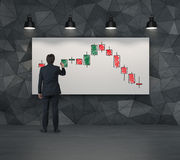 Color candlestick chart on placard Stock Images