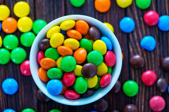 Color candy. In bowl and on a table Stock Image