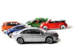 Color car toys. On the white background stock photos
