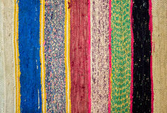 Color carpet. Colored striped traditional color carpet in home Stock Photos