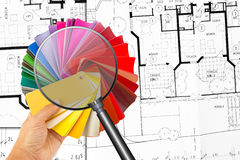 Color cart in the hand with magnifier Stock Photography