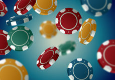 Color casino chips falling in different positions on retro background. Poker turquoise backdrop with defocused blur elements Royalty Free Stock Photo