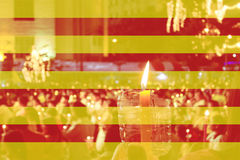 Color of Catalan flag with people holding candle. Color of Catalan flag with people holding candle in background Royalty Free Stock Images