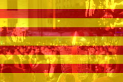 Color of Catalan flag with people holding candle. Color of Catalan flag with people holding candle in background Stock Photo