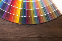 Color Catalogue on wooden desk. Colorful color paint catalogue on wooden desk Royalty Free Stock Photography