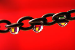 Color chain. Chain with water drops colored with multiple colors Royalty Free Stock Photos