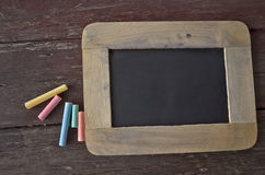 Color chalk and black stone board Royalty Free Stock Photo