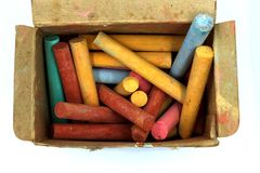 Color chalks stick in old paper box isolated on white background royalty free stock images