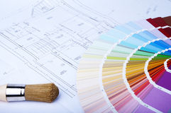 Color chart and brush. On the blue prints home Plans Royalty Free Stock Photography