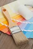 Color chart guide with brush and paint roller Stock Photos