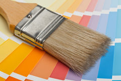 Color chart guide with brush. Color chart guide for renovation with brush on wooden surface stock images
