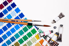 Color chart guide, brushes and paint tube. Royalty Free Stock Images
