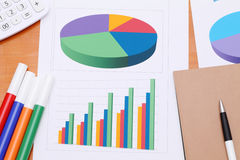 Color chart printed documents. Calculator and pen. Concept image of data gathering Stock Photo