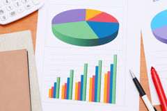 Color chart printed documents. Calculator and pen. Concept image of data gathering Stock Photography