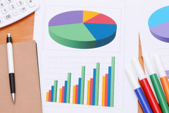 Color chart printed documents. Calculator and pen. Concept image of data gathering Royalty Free Stock Photos
