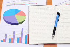 Color chart printed documents. With opened notebook Royalty Free Stock Photo